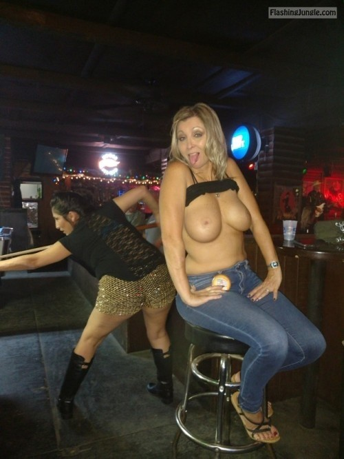 nudeandnaughtyflashing: rustyalan464 chilling at the bar playing... public flashing boobs flash