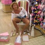 Pantyless cougar at the shoe store