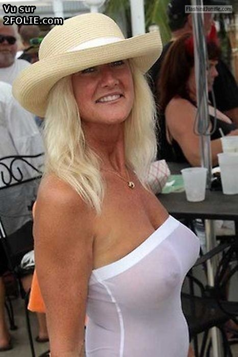 MILF in white hat: big round tits see through white blouse voyeur public flashing milf pics boobs flash bitch