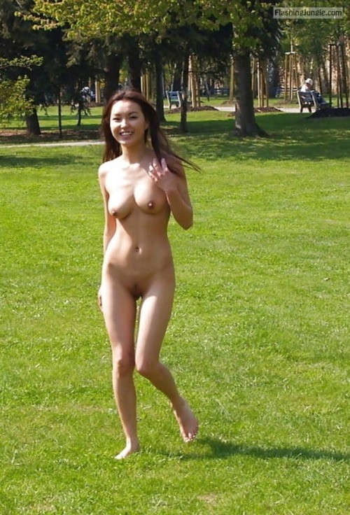Skinny Chinese girl in city park public nudity