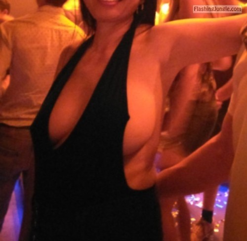 Braless side boobs in the night club public flashing boobs flash bitch
