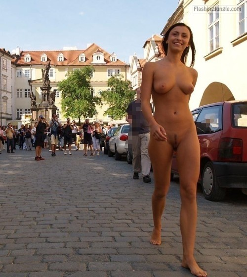 Entertaining the tourists on the street with her hot naked body public nudity
