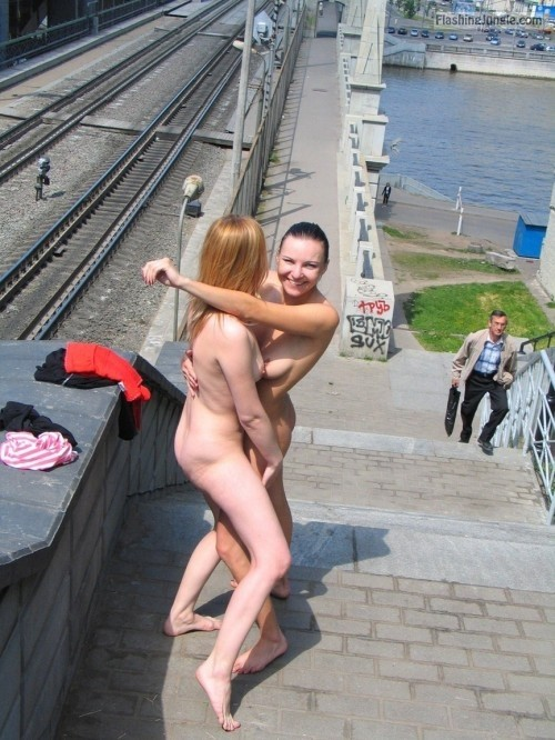 girls naked outdoors Hugging on rail bridge public nudity