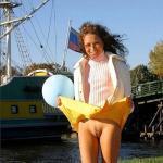 Yellow skirt up pantieless – windy day on riverband