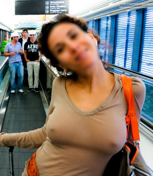 Braless and horny at the airport public flashing pokies pics boobs flash