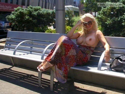 Smiling blonde with huge breasts topless on bench public flashing boobs flash