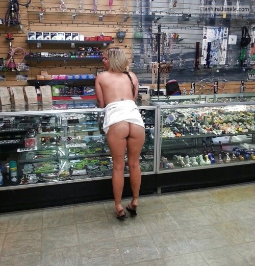 carelessinpublic:Almost topless inside a shop in a short skirt... public nudity