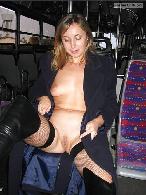 carelessinpublic:Almost nude inside a bus and showing her boobs... public nudity