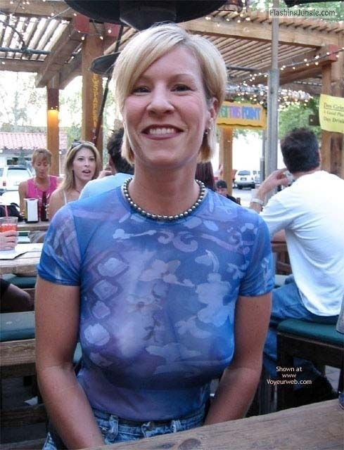 carelessinpublic:Mature lady showing her boobs in her... public flashing