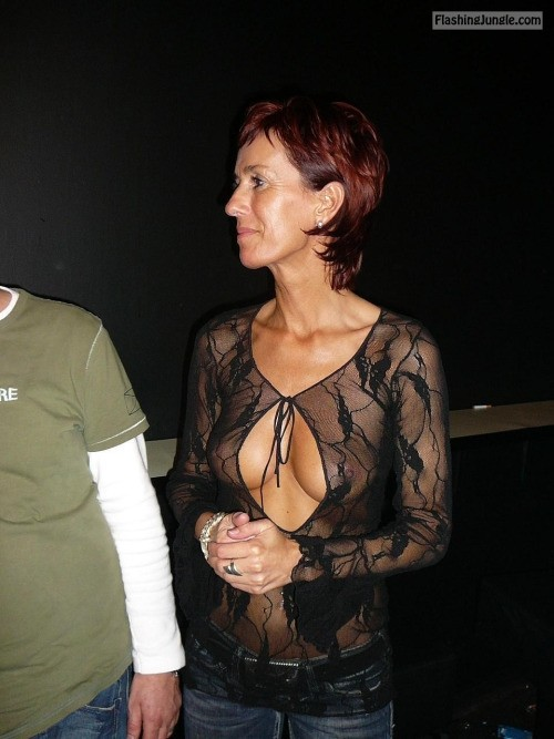 carelessinpublic:Milf showing her boobs in her transparent dress public flashing