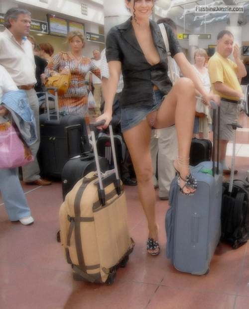 carelessinpublic:In a short skirt and showing her pussy in a... public nudity