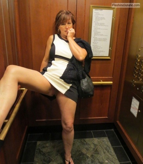 Naughty sexy MILF… public flashing