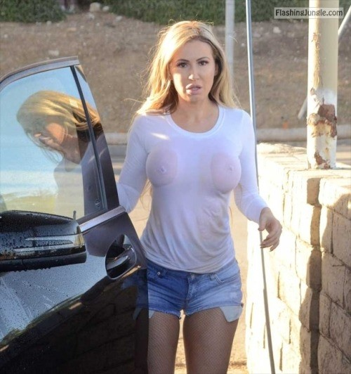 carelessinpublic:Ana Braga showing her boobs in her wet... public flashing