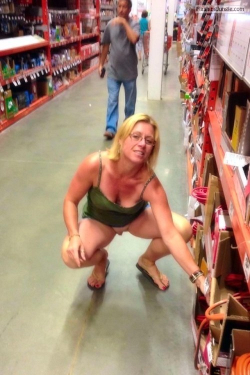 carelessinpublic:Inside a shop in a short dress and showing her... public flashing