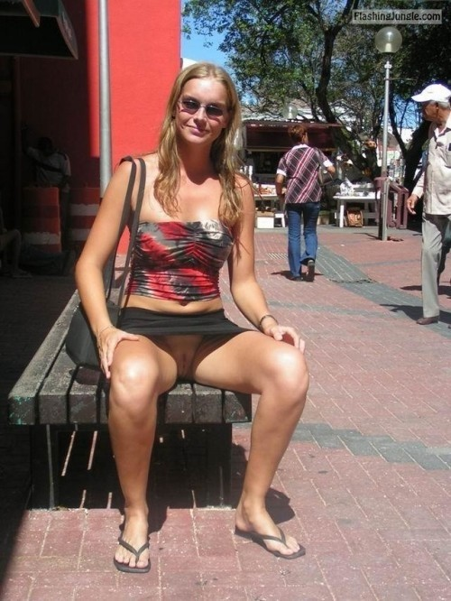 carelessinpublic:In a short skirt and showing her pussy public flashing