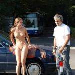 nudegirlsinpublic:Naked in public with boots and a fan Follow me…