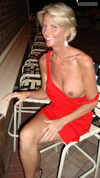 Slim lady boob out in red dress with a big smile public flashing