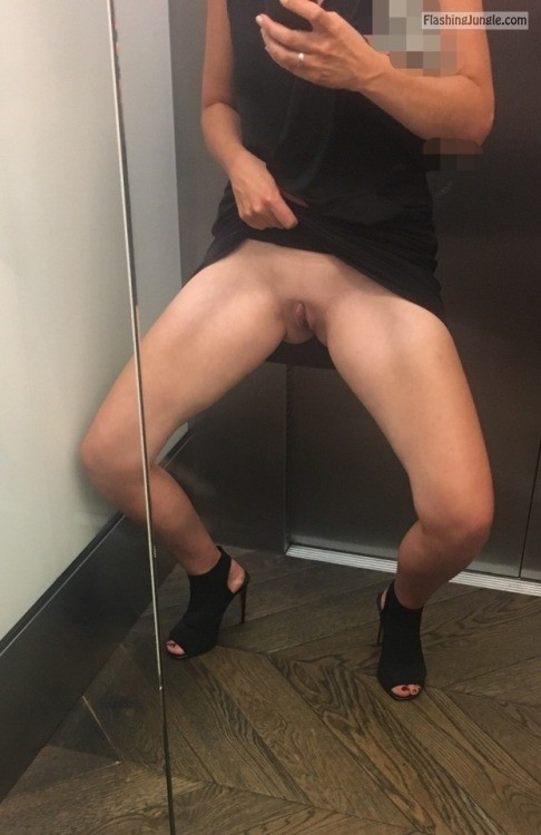 nudenaughtyandfree: In the lift no panties