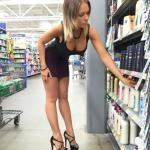 Incredibly sexy blonde shows off her tight body in black dress