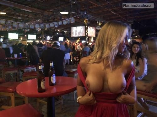 Luxury blonde girl in red dress pops out big breast and the club public flashing boobs flash