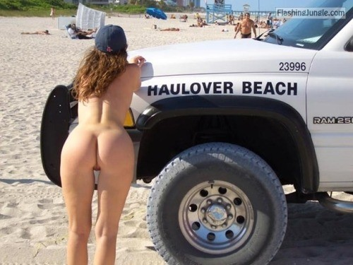 Slightly bend over beach truck while wearing nothing except hat on her curly hair public nudity nude beach ass flash