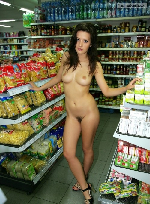 College slut with dark hair and dark pussy bush fully nude at supermarket public nudity