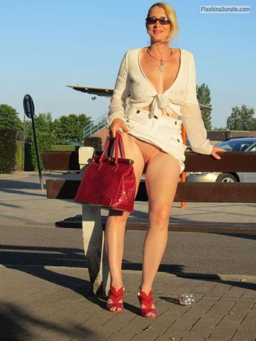 Blond MILF no panties under white clothes   Reed heels and red handbag... public flashing