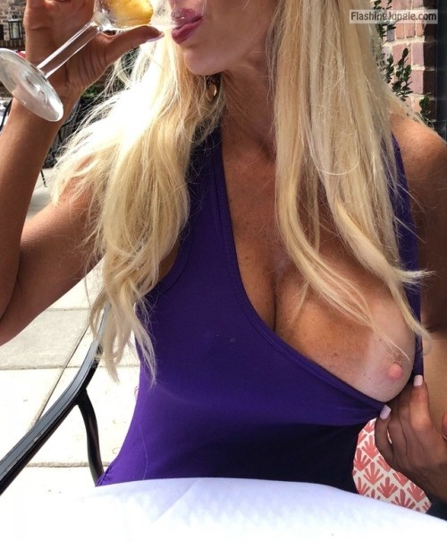 Rich blonde in blue dress one big boob out at restaurant boobs flash
