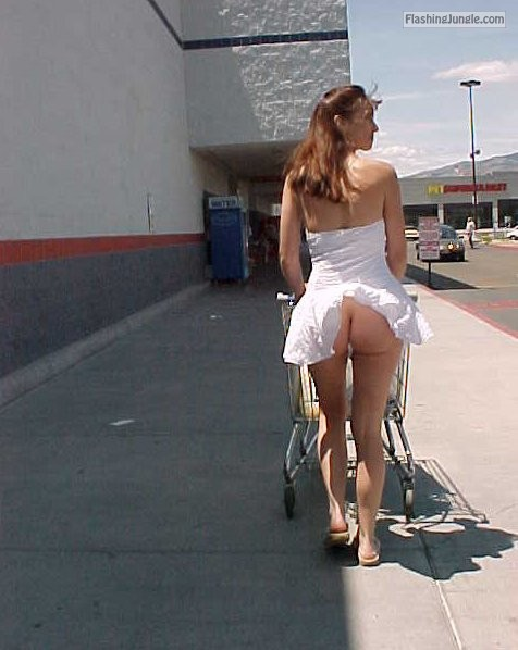 No panties under white dress Outside a shop in a short dress and showing... public nudity