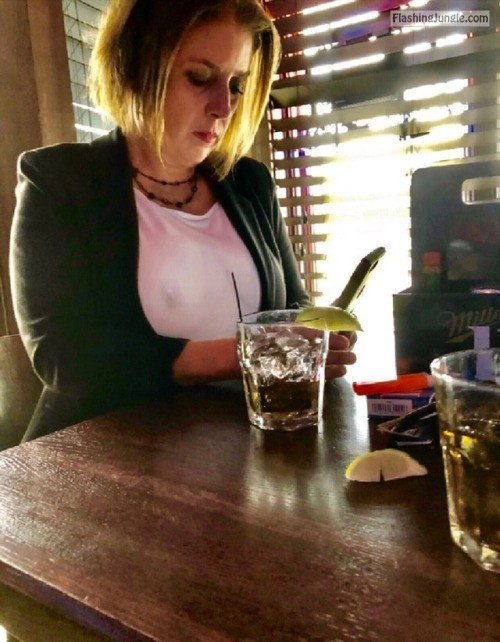 Voyeur caught nipple under white blouse of sexy cougar in pub while texting milf pics