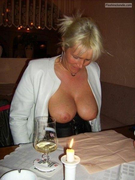 A nice pair of big veiny mature tits at restaurant   Blonde MILF boobs flash