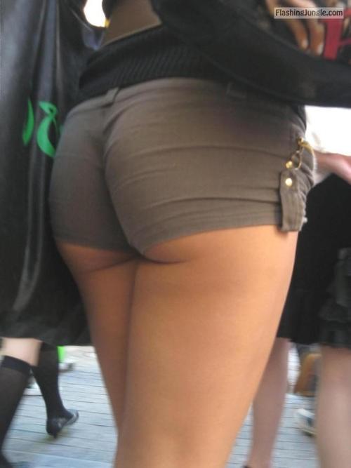 Underbutt in tight grey shorts voyeur