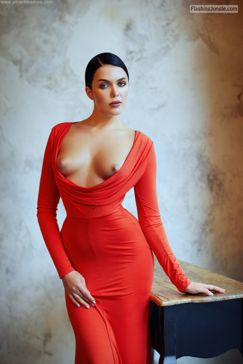 Luxury red evening dress with too big decolletage boobs flash