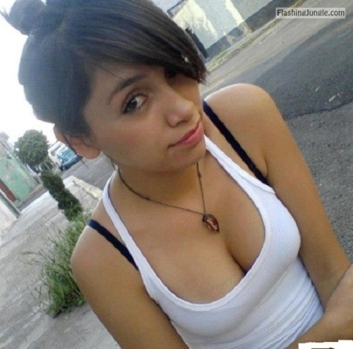 Some would say that the black bra detracts from her cute tank... public flashing