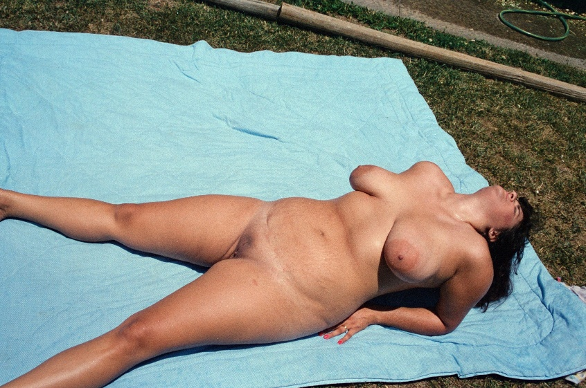 Naked outside in the backyard or frontyard
